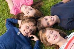 Kids lying on grass Stock Photography