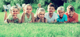 Kids lying on green grass Royalty Free Stock Images