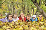 Kids lying on leaves Royalty Free Stock Photography