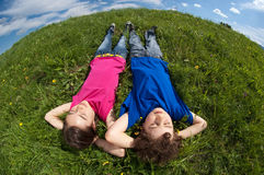 Kids lying outdoor Stock Photography