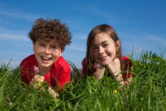 Kids lying outdoor Royalty Free Stock Photography