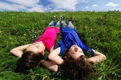 Kids lying outdoor Stock Photo