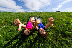 Kids lying outdoor Stock Photo