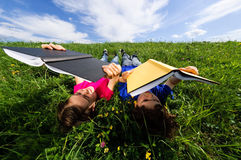 Kids lying outdoor stock photography