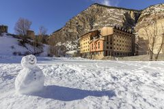Kids made Snowman in Canillo village outdoor park. Andorra. Royalty Free Stock Photography