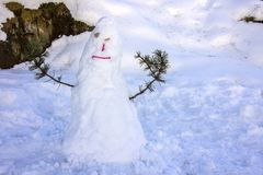Kids made Snowman in Canillo village outdoor park. Andorra. Royalty Free Stock Photo