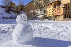 Kids made Snowman in Canillo village outdoor park. Andorra. Royalty Free Stock Image