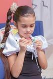 Kids make bracelets together Stock Image