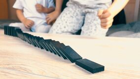 Kids Make A Domino`s Fall on the Table Slow Motion