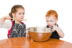 Kids making cake. In large mixing bowl. Isolated on white Stock Image