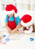 Kids making christmas cookies. Cutting the dough Royalty Free Stock Photos
