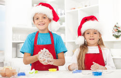 Kids making christmas cookies Stock Image