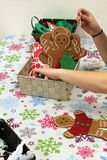 Kids Making Christmas Craft Ornaments. Kids making Christmas snowmen and gingerbread men ornaments crafts for gifts stock photo