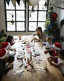 Kids making a Christmas DIY project Royalty Free Stock Images