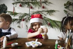 Kids making Christmas DIY projects Stock Photography