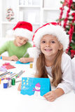 Kids making christmas greeting cards Stock Photography
