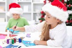 Kids making christmas greetings royalty free stock images