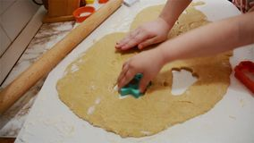 Kids are making cookies stock footage