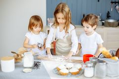 Kids making cookies in the kitchen.  Royalty Free Stock Photos