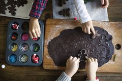 Kids making and decorating Christmas cookies Stock Photography