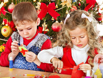 Kids making decoration for Christmas. Stock Image