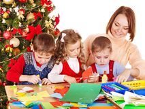 Kids making decoration for Christmas. Stock Photos