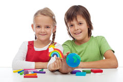 Kids making ecology theme clay figures stock images