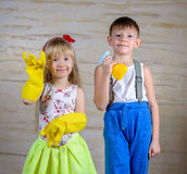 Kids Making Fun with Cleaning Gloves and Spray Stock Image