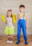 Kids Making Fun with Cleaning Gloves and Spray Royalty Free Stock Photo