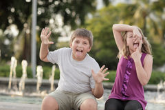 Kids making funny faces Stock Images