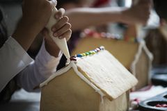 Kids making gingerbread houses cookies Royalty Free Stock Image