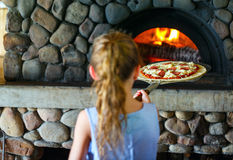 Kids making pizza. Adorable little kids making pizza at cooking class royalty free stock photo