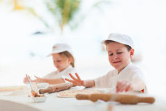 Kids making pizza Stock Image