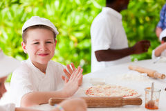 Kids making pizza Stock Photo