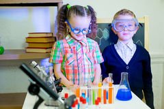 Kids making science experiments Stock Images