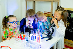 Kids making science experiments Stock Photos