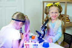 Kids making science experiments Royalty Free Stock Photos