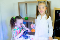 Kids making science experiments Stock Photography