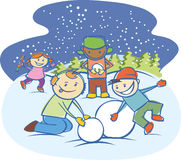 Kids making a snow man isolated Stock Images