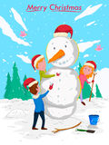 Kids making Snowman with Santa cap for Merry Christmas celebration Royalty Free Stock Photography