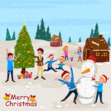 Kids making Snowman with Santa cap for Merry Christmas celebration Royalty Free Stock Photo