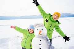 Kids making a snowman Stock Images