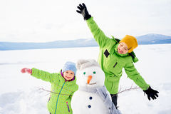 Kids making a snowman Stock Photography