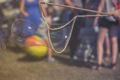 Kids making  soap bubble in garden, vintage effect Royalty Free Stock Images
