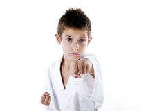 Kids in martial art. Young boy concentrated training in martial art Stock Images