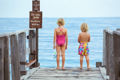 Kids with masks, fins going to snorkel in tropical sea royalty free stock image
