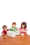 Kids measuring and mixing flour in kitchen bowl Stock Image