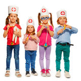Kids with medical caps and toy doctor tools Royalty Free Stock Photography