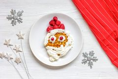 Kids menu Christmas breakfast waffles top view. On wooden background Stock Photo
