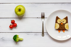 Kids menu owl shaped sandwich with vegetables and fruits Royalty Free Stock Photography